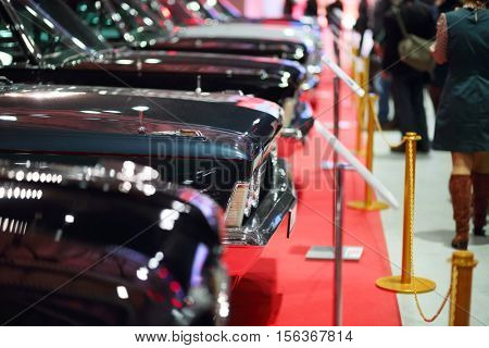MOSCOW - MAR 07, 2016: Hoods of black shiny cars at exhibition Oldtimer-Gallery in Sokolniki Exhibition Center. It is only one in Russia exhibition of vintage cars and technical antiques