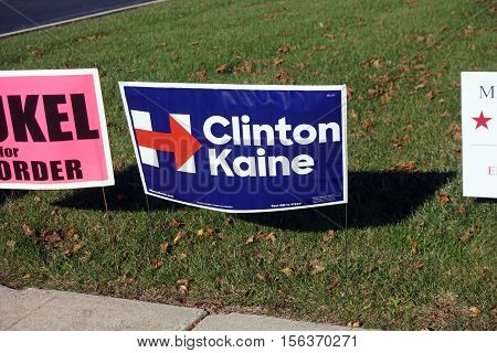 JOLIET, ILLINOIS / UNITED STATES - NOVEMBER 8, 2016: A lawn sign endorses Hillary  Clinton and Timothy Kaine, for President and Vice President, outside the Wesmere Elementary School, which serves as a polling place on election day.