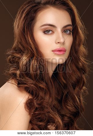 Beautiful Girl With Long Wavy Hair. Redhead Girl With Curly Hairstyle.