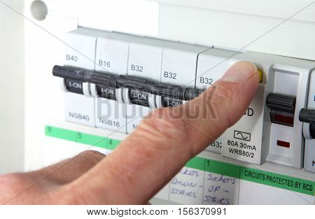 Testing an RCD (Residual Current Device) on a UK domestic electrical consumer unit or fuse box poster