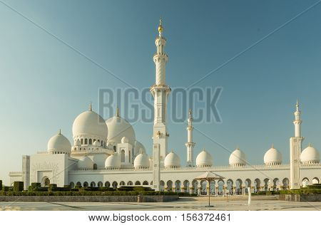 Amazing Mosque. Sheikh Zayed Grand Mosque at sunset time (Abu-Dhabi UAE). Sheikh Zayed. Abu Dhabi. Sheikh Zayed Mosque in Middle East United Arab Emirates with reflection on water. Abu Dhabi.