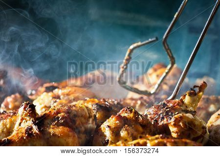 Barbecue chicken with cherbs on hot grill