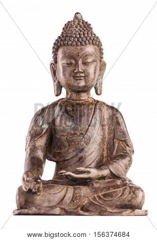 Buddha Shakyamuni's figure in a blessing pose - varada mudra. The old statue made of metal isolated on a white background.