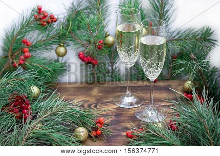 Christmas Holiday Composition With Champaign, Pine Branches, Red Berries