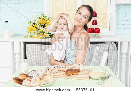 At the table sat mother and the child.