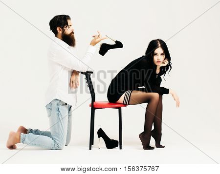Sexy Couple On Chair With Shoes
