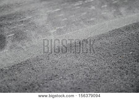 Steam coming out from asphalt after paving with a steel wheel roller