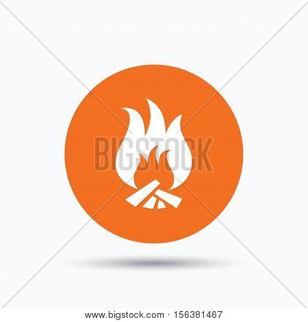 Fire icon. Blazing bonfire flame symbol. Orange circle button with flat web icon. Vector