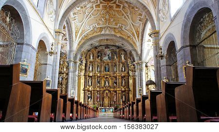 Interior view of Church of Santo Domingo (Templo y exconvento de Santo Domingo de Guzmán). It is a Roman Catholic church within the jurisdiction of the Roman Catholic Archdiocese of Puebla de los Angeles, with the archangel Michael as its patron saint.