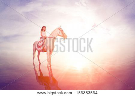 Beautiful woman on a horse. Horseback rider, woman riding horse on beach