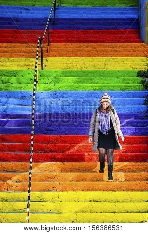 Istanbul Turkey - February 02 2014: A Turkish woman is walking in the rainbow-colored stairs on February 02 2014 in Istanbul. Rainbow-colored stairs in Istanbul. Stairs in the Cihangir and Findikli neighborhoods which attracts attention after being painte