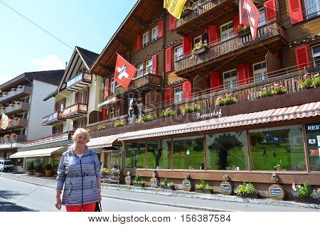 WENGEN, SWITZERLAND - SEPTEMBER 19, 2016 : View of central street in Wengen, Switzerland.Wengen has 1,300 year-round residents, which swells to 5,000 during summer and to 10,000 in winter