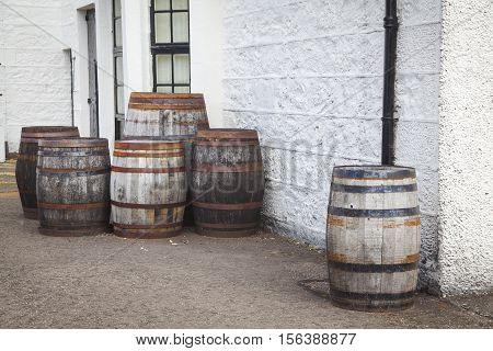 Old Whiskey barrels in front of a distillery
