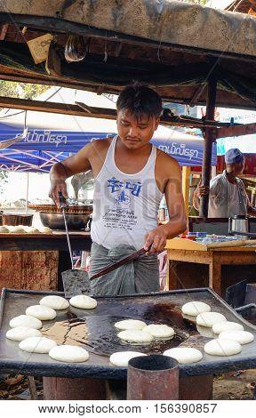 Burmese Vendor Selling Food In A Local Restaurant