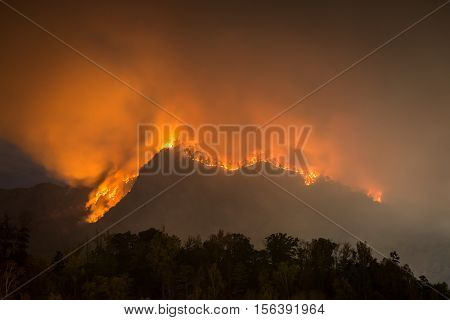 The forest fire claiming more acres at Party Rock at Lake Lure in the Blue Ridge Mountains of North Carolina.