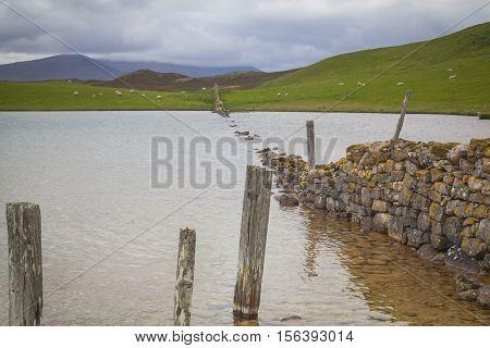 Sunken dry wall near Durness Lairg Scotland
