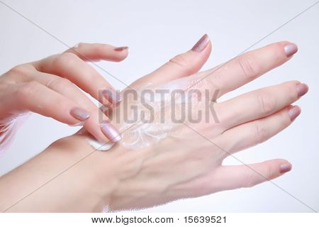 Woman Applying Moisturizing Cosmetic Creams On Her Hands