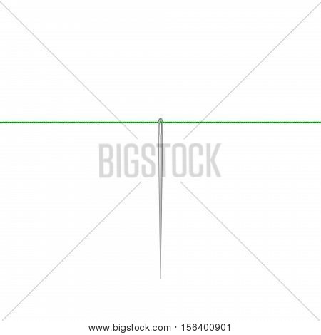 Needle in silver design hanging on green thread on white background
