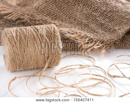 Skein of jute twine. Clew of natural rope. Roll of twine jute on sacking