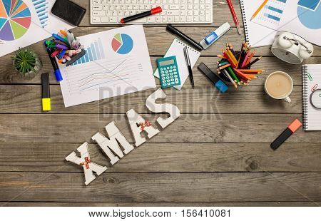Word xmas with charts and office objects on the wooden desk top view