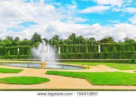 Versailles,  France- July 02, 2016 : Fountain Near The Flower Bed In A Famous Gardens Of Versailles