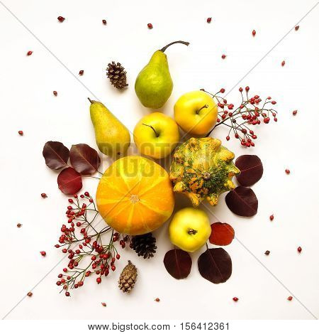 Stylish composition of colorful vegetables fruits autumn leaves and berries. Top view on white background. Autumn flat lay