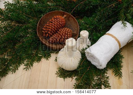 Spa treatment with Christmas decorations on wooden board