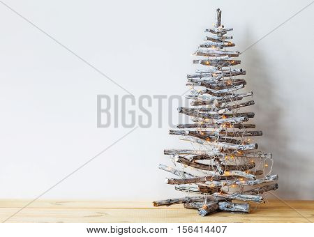 Christmas tree made of wooden branches with copy space