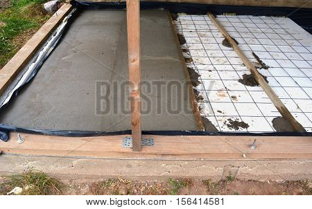 Insulating new house floor with polystyrene and concrete