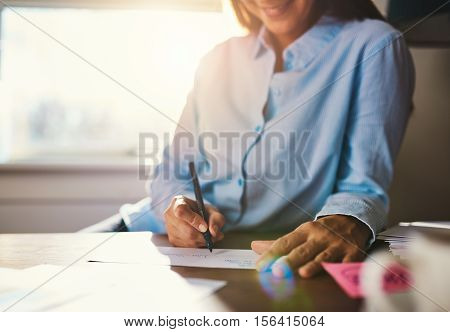 Closeup View Of Hands Writing On Envelope