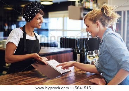 Female Customer Choosing Wine In A Bar