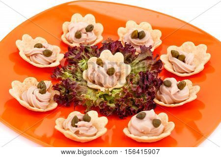 Fish cream and capers in pastries lettuce on plate.