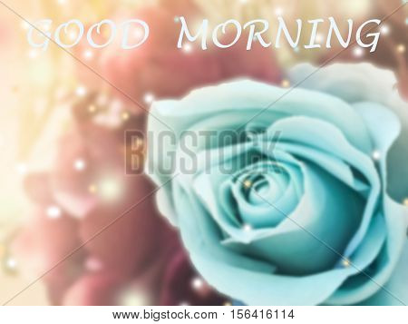 sweet dreamy and de-focused Good morning word on vintage background bouquet of blue roses with flare light