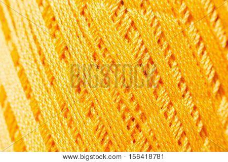 Orange knitting thread texture, handiwork backdrop. Bright handiwork background, crochet iris string, Leisure, hobby, needlework concept