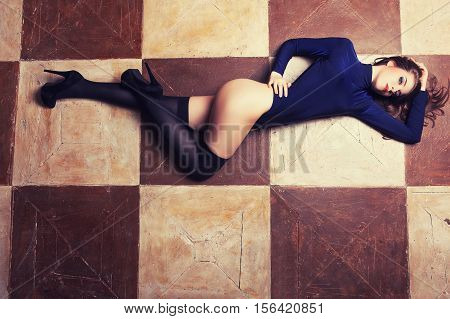 Sexy Woman In Lingerie Lying On Chess Floor In Vintage Toning