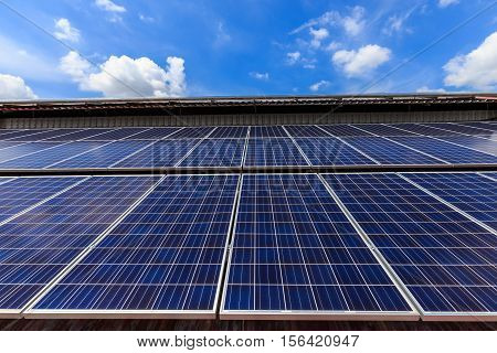 Solar Cell On Roof Top Against Blue Sunny Sky