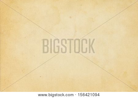 Aged yellowed and stained paper background. Natural old paper texture for the design.