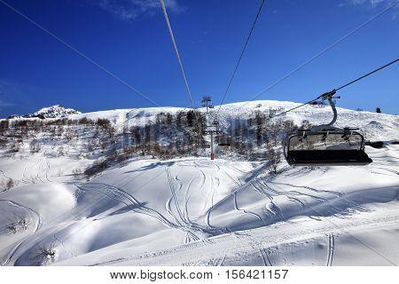 Chair-lift At Ski Resort In Sun Winter Day