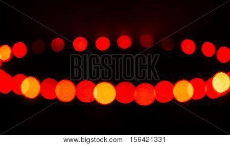 Glowing abstract light spots on dark background