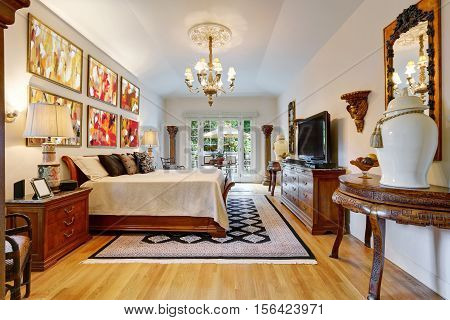 Luxury Master Bedroom Interior With Carved Wooden Furniture.