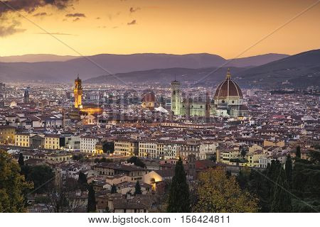Florence or Firenze sunset aerial cityscape. Palazzo Vecchio and Duomo Cathedral. Tuscany Italy
