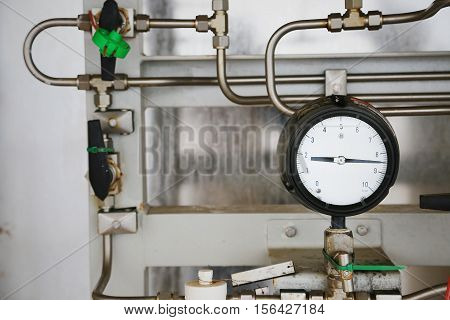 Pressure gauge in oil and gas production process for monitor condition, The gauge for measure in industry job, Industry background and close up gauge, gauge for measure pressure in the process.