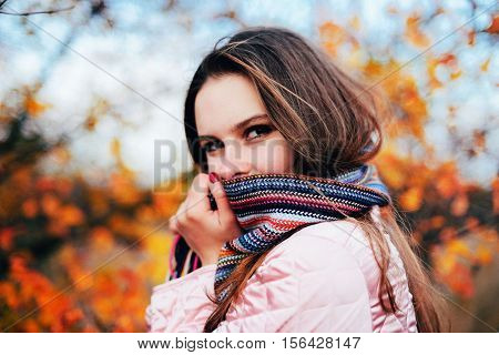 Closeup outdoors portrait of gorgeous young Caucasian woman. outdoors in park on sunny fall day. colorful autumn portrait. Portrait of a beautiful dreamy girl with long hair. in autumn park