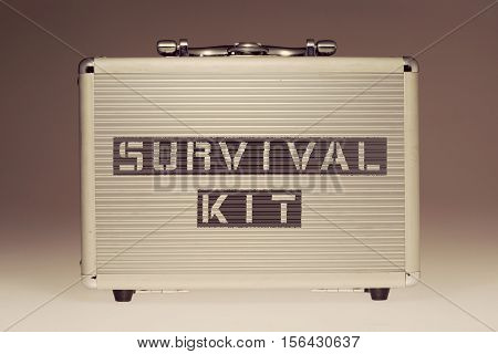 metallic case with survival kit phrase stencil print on it side