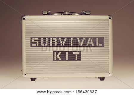metallic case with survival kit phrase stencil print on it side