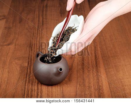 Spilling Tea In Teapot