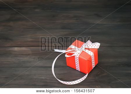 Gift Box Tied With A Red Ribbon , Fir Branches,candy And Christm