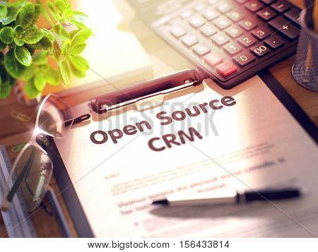 Clipboard with Concept - Open Source CRM with Office Supplies Around. 3d Rendering. Blurred Toned Illustration.