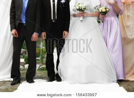 Fiancee and fiance at the wedding ceremony