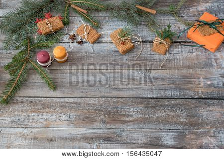 Xmas or New Year background holiday plain composition made of Christmas decorations on a wooden background top view with copy space